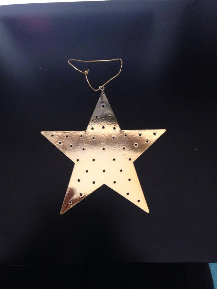 a metallic gold star sits against a dark background